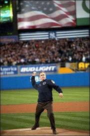 President Bush tosses out the ceremonial first pitch before a 2-1 Yankee victory in Game 3 of the 2001 World Series.