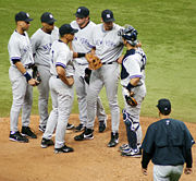 An in-game meeting on the mound featuring, from left to right, Derek Jeter, Robinson Cano, Alex Rodriguez, Jason Giambi, Randy Johnson, Jorge Posada, and Joe Torre.